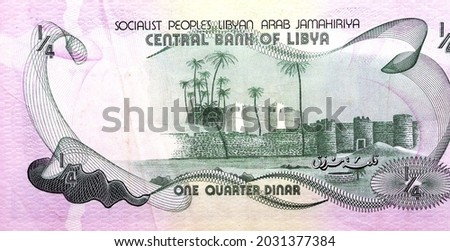 Large fragment of the reverse side of one quarter Libyan dinar banknote currency issued 1981 by the central bank of Libya with Marzuq fortress castle, vintage retro, old Libyan money banknote. Stockfoto ©