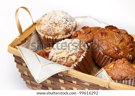 Large fresh muffins in a cane basket