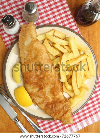 Large fried cod fillet with chunky chips.