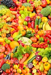 Large fruit pattern of fresh and healthy colorful vegetables and fruits. Vertical background.