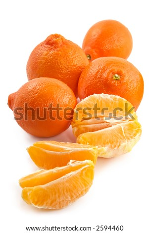 Large fruits of a juicy tangerine and fragrant segments on a white background
