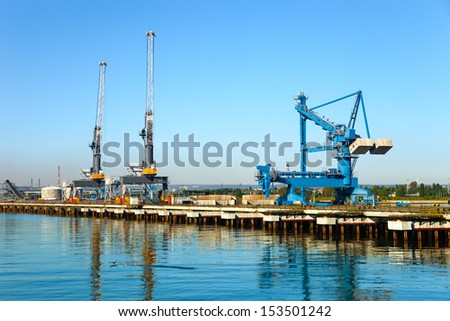 Large gantry and cranes at the port of Gdansk, Poland.
