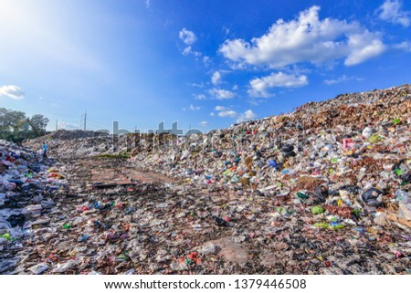 Large garbage mountains that accumulate waste from industrial and urban areas in the 3rd world country.
