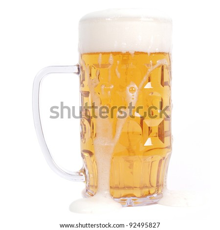 Large German bierkrug beer mug glass of Lager - isolated over white background