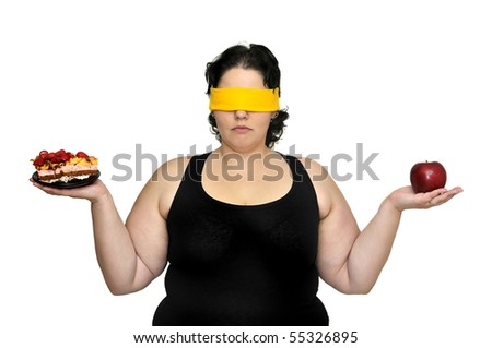 Large girl blindfolded holding a cake and an apple isolated in white