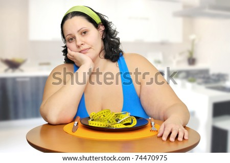 Large girl eating a measuring tape