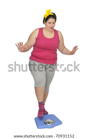 Large girl holding a scale isolated in white