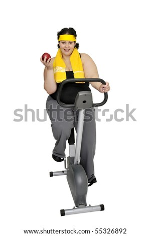 Large girl with fitness bicycle holding an apple isolated in white - stock photo