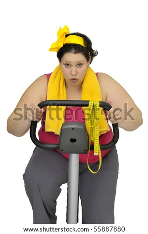 Large girl with fitness bicycle isolated in white