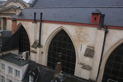 Large glass in lead windown of a church, photographed from the roof of the next building