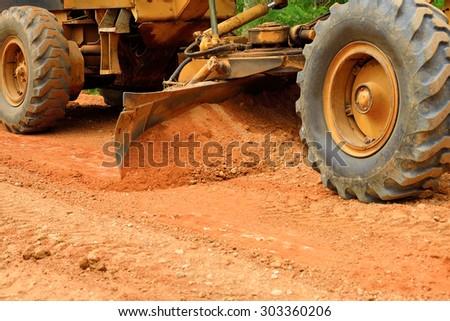 large grader  a narrow rural road