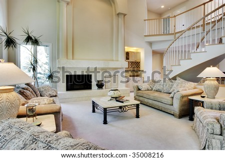 Large great room with sofas and lamps