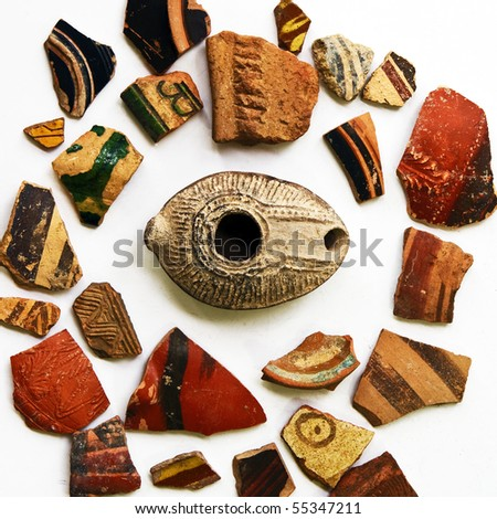 Large group of ancient colorful ceramic artifacts from different ...