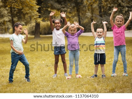 Large group of children poses to camera.  #1137064310