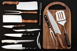 Large Group Of Cookware Isolated On Black Background. Many Knives  and Grilling Tool on Black Table. Collection Of Different Utensils For Cookout Food, Abstract Pattern. Set Of Many Cookware Objects