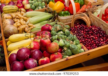 large group of fall harvest vegetables including corn and apples - stock photo