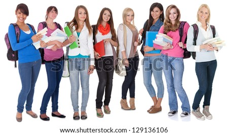 Large group of female students. Isolated on white
