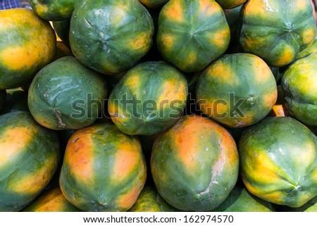 large group of fresh ripe papaya displayed for sale in market. Raw healthy fruit. Papaya spa and resorts