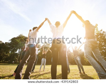 large group of friends together in a park having fun #439142803