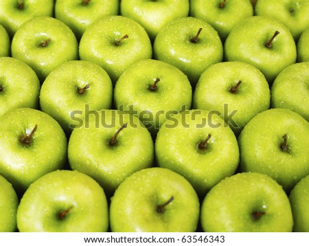 large group of green apples in a row. Horizontal shape