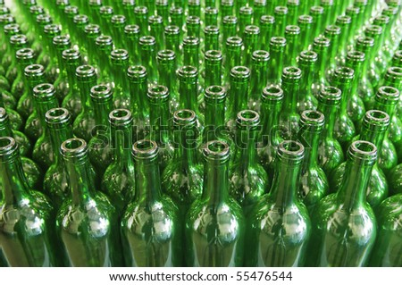 Large group of green recycled glass wine bottles