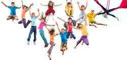 Large group of happy cheerful sportive children jumping, sporting and dancing. Isolated over white background. Childhood, freedom, happiness, active lifestyle concept.