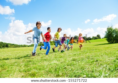 Large group of happy kids, boys and girls running in the park on sunny summer day in casual clothes #155271722
