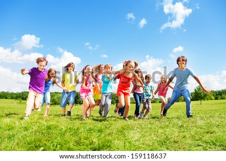 Large group of kids, friends boys and girls running in the park on sunny summer day in casual clothes #159118637