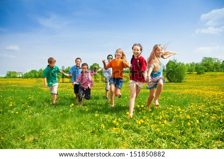Large group of kids running in the dandelion spring field #151850882