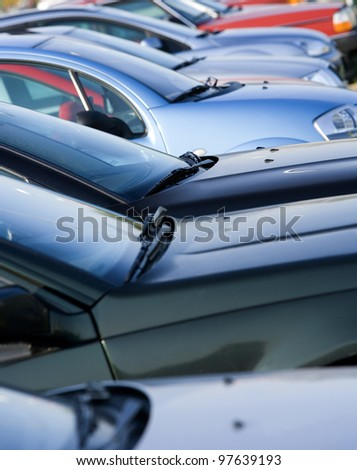 Large group of Parked Cars in a row