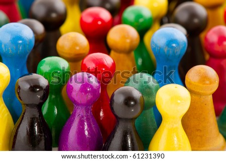 Large group of people in many colors in abstract