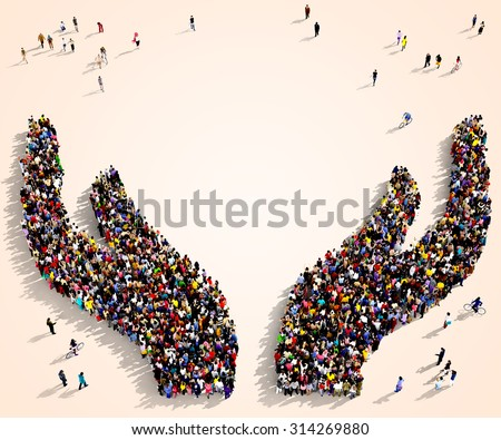 Large group of people seen from above gathered together in the shape of two protective hands