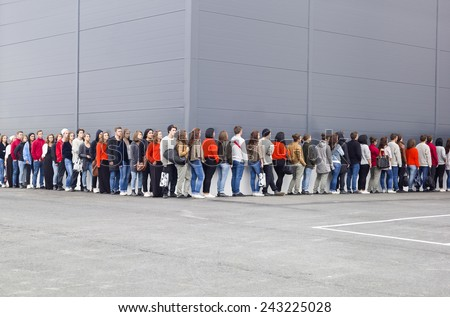 Large group of people waiting in line #243225028