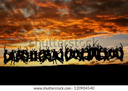 large group of teens jumping in sunset