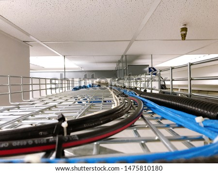 Large group of UTP cables, Ethernet cables and Fiber in cable tray. #1475810180