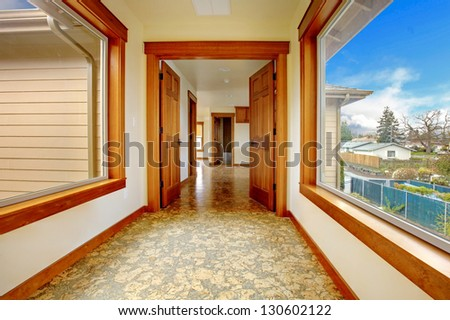 Large hallway in empty house with cork floor. New luxury home interior.