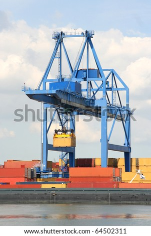 Large harbor crane and containers in Rotterdam harbor
