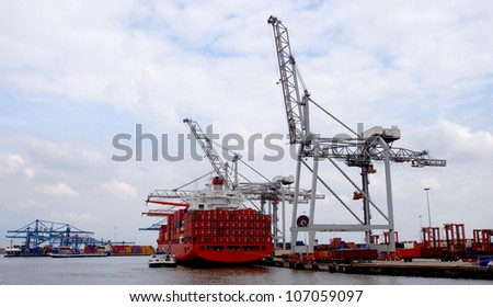 Large harbor cranes at the port of Rotterdam , Holland