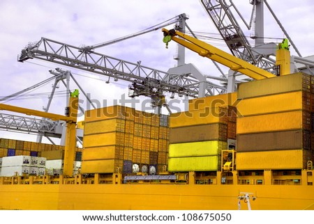 Large harbour cranes at the port of Rotterdam , Holland europoort