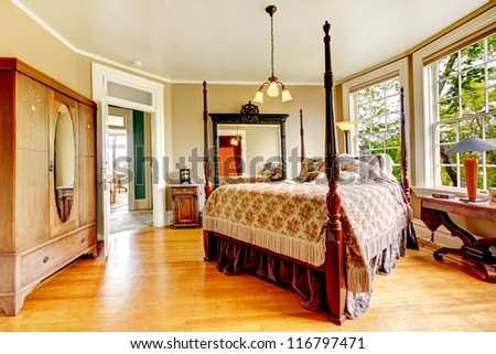 Photo of Large historical Inn room interior - bedroom with antique post bed.