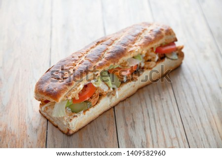 Large hoagie sandwich with veggies and meat #1409582960