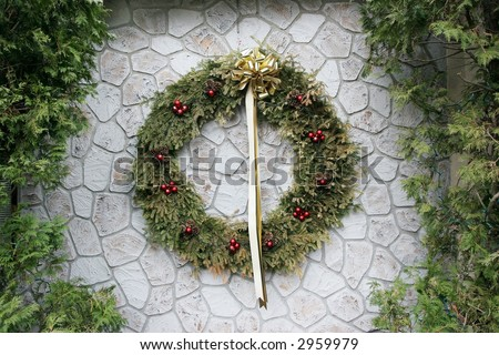 large holiday wreath on wall