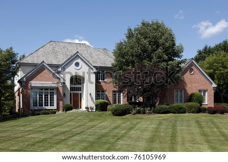 Large home in suburbs with arched entry