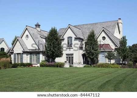 Large home with arched entry and cedar roof