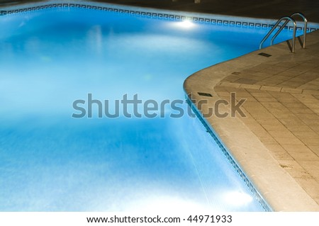 large hotel swimming pool at night with lights managua nicaragua