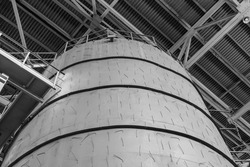 Large industrial capacity. Metal constructions. The concept of a plant, brewery. Monochrome image.