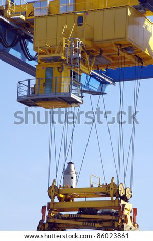 Large industrial crane for cargo containers in harbour - stock photo