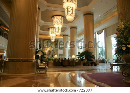 Large interior with high ceiling and posh chandeliers