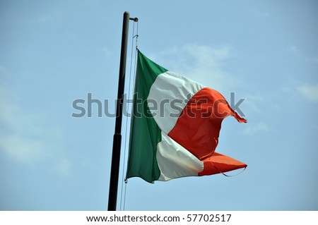 Large Italian flag floating in the wind