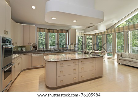 Large kitchen in luxury home with center island